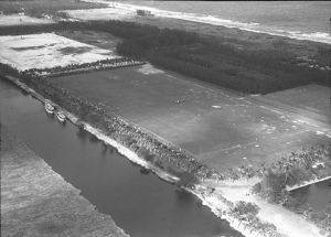 Photographed in Town of Gulf Stream, Florida, Date:1930s, Polo was a highly regarded sport in Gulf Stream as can be seen during this polo match, circa 1930s. Hundreds of spectators came to watch the matches. Some anchored their yachts in the Intracoastal, while others parked their cars in double rows along the palm-lined fields. In the distance, one can see the ocean and the original configuration of SR A1A adjacent the beach. It has since been relocated to the west.